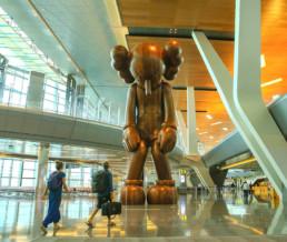 Kaws, small lie, Street art, contemporary, Qatar, airport, international, giant